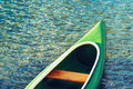 Green plastic canoe on lake Royalty Free Stock Photo