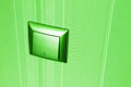 Green plastic electric light switch Royalty Free Stock Photo