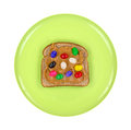 Green plate with peanut butter and jelly beans on wheat bread top view of a a single slice of several a white background Royalty Free Stock Photography