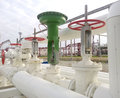 Green pneumatic valve on the pipeline equipment of oil plant Stock Images