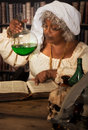 Green poison old time alchemist working in her laboratory with in a flask Stock Photography