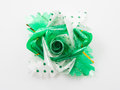 Green polka dot gift bows with ribbon on white Royalty Free Stock Photos