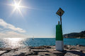 Green port signal signar in a sunny day Stock Images
