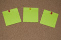 Green Post it Notes on a Cork Board Royalty Free Stock Photo