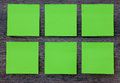 Green post it notes on the wood background Royalty Free Stock Photo