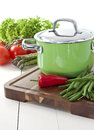 Green pot and fresh vegetables Stock Images