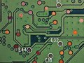 Green printed circuit board PCB hard drive. Fragment of printed wiring board PWB close up. Conductive pattern. IT&C. Background or Royalty Free Stock Photo