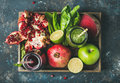 Green, purple fresh juices with fruit, greens, vegetables in tray Royalty Free Stock Photo