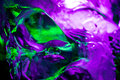 Green purple ice a block of carved at an bar Royalty Free Stock Image