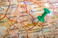 Green pushpin on a touristic map route your trips Stock Photography