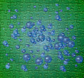 Green puzzle pattern with blue bubbles Royalty Free Stock Images