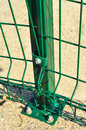 Green railings detail close up shot of on a downslope on a walking trail near the sea shore Stock Image