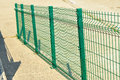 Green railings on a downslope on a walking trail near the sea shore Royalty Free Stock Photos