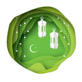 Green Ramadan Kareem Greeting card. Paper cut hanging traditional arabic lamps.