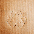 Green recycle symbol on cardboard Royalty Free Stock Photo
