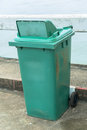 Green recycling bin on the road side Stock Photo