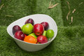 Green and red apples in a big white dish the fruit bowl filled with assorted fresh fruits Royalty Free Stock Photography