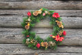 Green with red and gold Christmas conifer wreath Royalty Free Stock Photo