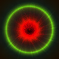Green red neon luminous luminescent circle on black background.