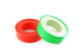 Green and red scotch tape adhesive rolls isolated on white Royalty Free Stock Photos