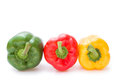 Green and red and yellow bell peppers Royalty Free Stock Photo