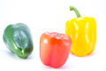Green red and yellow peppers isolated on white background Royalty Free Stock Photo