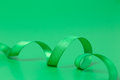 Green ribbon on background Royalty Free Stock Photography