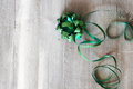 Green ribbon greeting card with gift box Royalty Free Stock Images