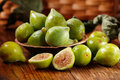 Green ripe figs on the wooden table Stock Image