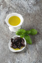 Green ripe olives and olive oil in a bowl. Dark background. Royalty Free Stock Photo