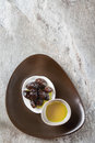 Green ripe olives and olive oil in a bowl. Dark background. Top Royalty Free Stock Photo