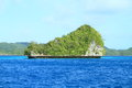 Green rock islands covered trees blue sea palau Stock Image