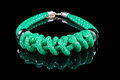 Green Rope Necklace. on black background Royalty Free Stock Photo