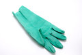 Green rubber glove in closeup over white background Stock Photo