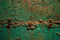 Green rusty metal with screws Stock Photography