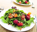 Green salad with berries and tomatoes Royalty Free Stock Image