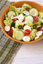 Green salad in  bowl on table. Tomato, cucumber and salat Royalty Free Stock Photo