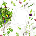 Green salad herbs flowers Food background tablet recipe book Royalty Free Stock Photo