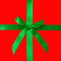Green satin bow on red Royalty Free Stock Photo