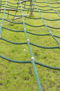Green scramble net on a child s climbing frame wood construction in children playground Royalty Free Stock Photos