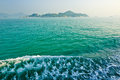 Green sea water and spindrift the photo was taken in mui wo hongkong china Royalty Free Stock Photo
