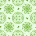 Green seamless floral background with b Stock Images