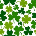 Green seamless pattern with four and tree leaf clovers. Vector illustration