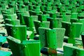 Green seats in a park Stock Image