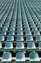 Green seats for spectators in the stadium Royalty Free Stock Images