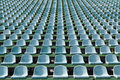 Green seats for spectators in the stadium Royalty Free Stock Photo