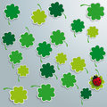 Green shamrocks shmarocks on the grey background eps file Stock Image
