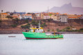 Green ship leaving the harbor in the morning Stock Images
