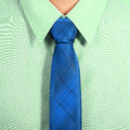 Green shirt with blue necktie close up Stock Photo