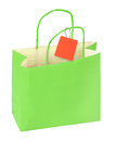 Green shopping bag blank price tag isolated white background Stock Image